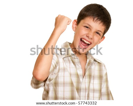 A happy handsome boy is holding his hand symbolizing victory; isolated on the white background - stock photo