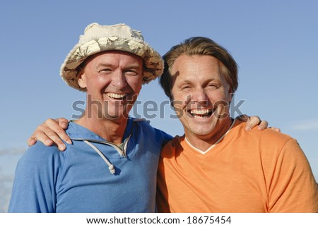 A happy laughing gay couple - stock photo