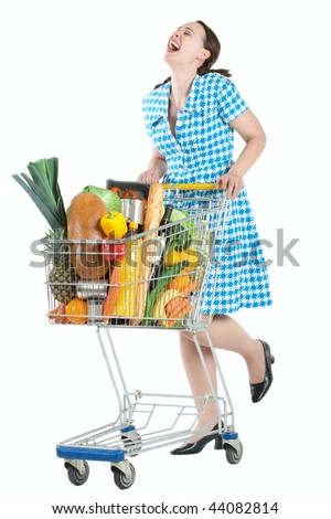 A happy laughing shopper in a vintage dress and a shopping cart - stock photo