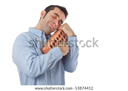 "A happy man tenderly hugging a brick as a symbol for ""all things real estate""."