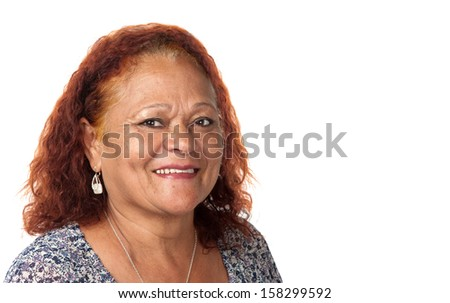 A happy mature woman delivers a delightful smile. - stock photo