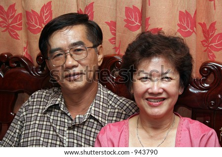 A happy, middle-aged asian couple. - stock photo
