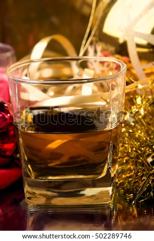 A happy moment of Christmas or New Year`s Eve where someone taking a drink to enjoy the celebration event, packing Christmas gifts and decorating with Christmas decoration.