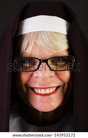 A happy nun with a friendly smile - stock photo