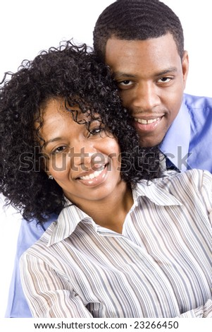 A happy professional african american couple smiles at the camera - stock photo
