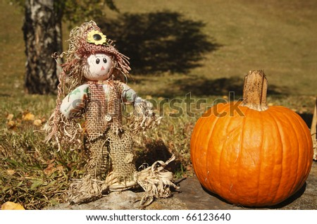 A happy scarecrow with pumpkin. - stock photo