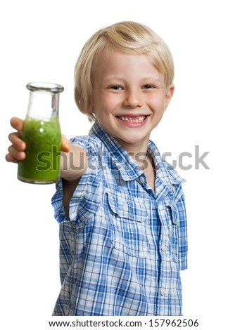 A happy smiling boy holding out a bottle of green smoothie or juice. Isolated on white. - stock photo