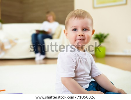 a happy smiling boy playing and having fun at home - stock photo