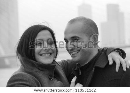 A happy smiling couple in the city - stock photo
