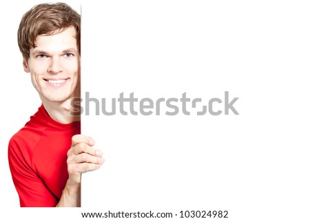 A happy smiling man holding a white sign - much space for your own text - stock photo