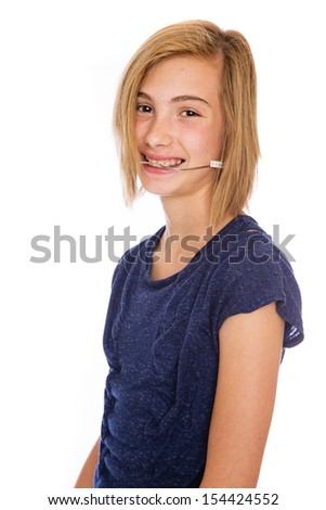 A happy teenage girl wearing corrective headgear for her teeth. - stock photo