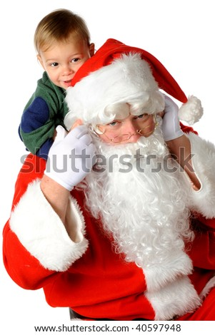 A happy toddler ridding piggyback on Santa Claus.  Isolated on white. - stock photo