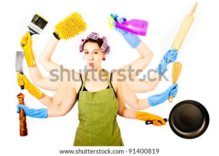 A happy very busy multitasking housewife - stock photo