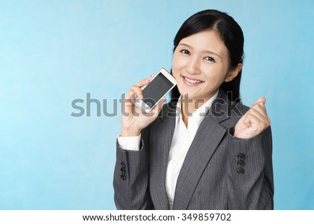 A happy woman with a smart phone