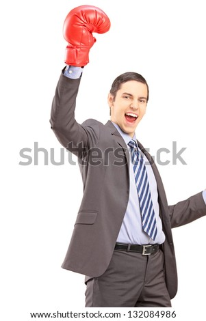 A happy young businessman with red boxing gloves gesturing happiness isolated against white background - stock photo