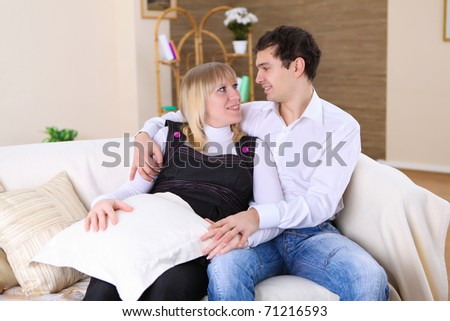 a happy young couple in love at home together