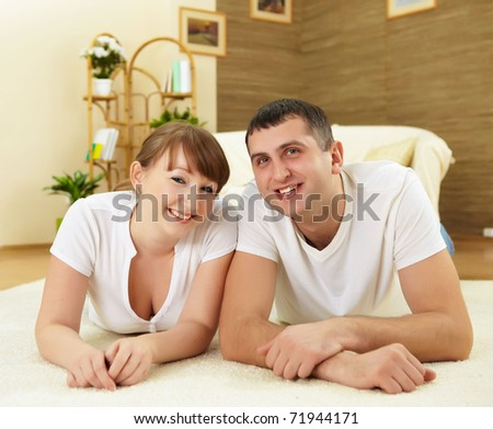 a happy young couple in love at home together - stock photo