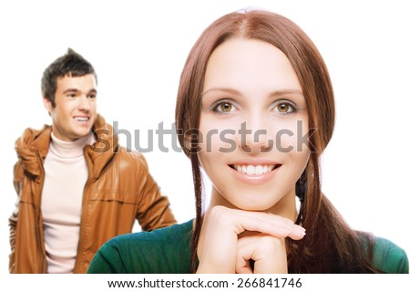 A happy young couple isolated on white background - stock photo