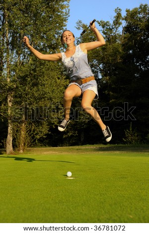 A happy young golfer. - stock photo