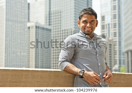 A happy young indian man from Malaysia.