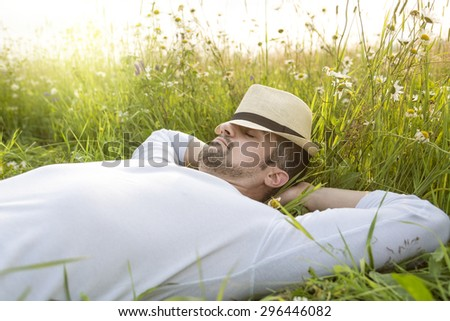 A Happy young man in a field