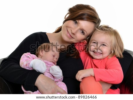 A happy young mother and her two daughters isolated on white background - stock photo