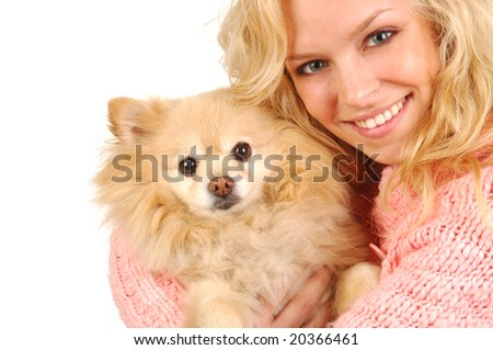 A happy young woman embracing her pomeranian. - stock photo