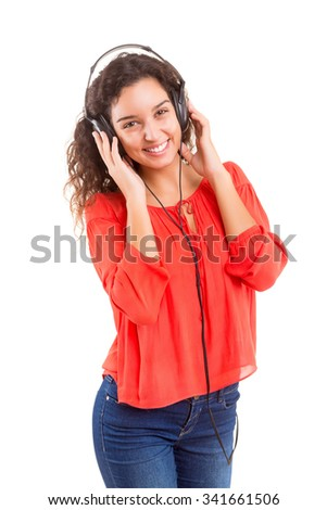 A Happy young woman listening to music - stock photo