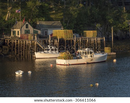 A harbor in Maine with lobster boats getting ready to sail. - stock photo