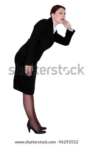 A hard hearing businesswoman. - stock photo