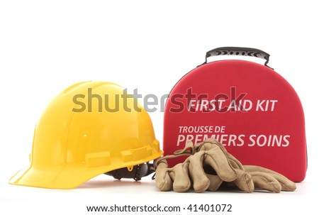 A hardhat, gloves, and a first-aid kit to promote safety in the workplace. - stock photo