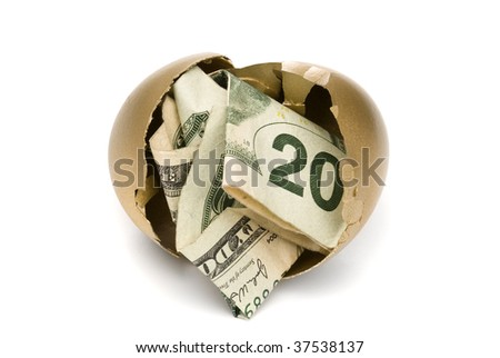A hatched golden egg reveals some cash for retirement. - stock photo