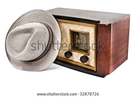 A HDR image of an old vintage radio with a hat on top - stock photo