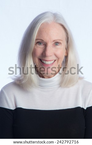 A head and shoulders portrait of a lovely, lively older woman