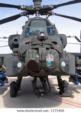 A head-on view of an Hughes AH-64 Apache Attack Helicopter - stock photo