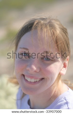 A head shot of a cute girl in the desert, with side lighting - stock photo