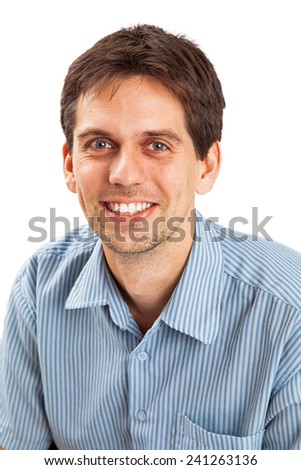 A head shot of a professional young man in his twenties wearing business casual clothing  - stock photo
