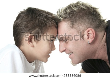 A Head to Head Father and Son. - stock photo