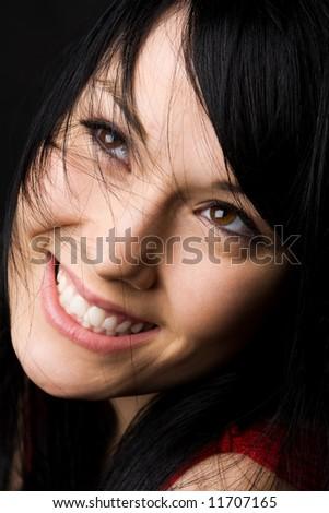 A headshot of a beautiful woman smiling - stock photo