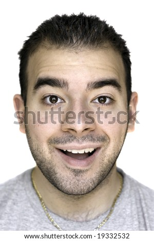 A headshot of a young man that is amazed or thrilled about something. - stock photo
