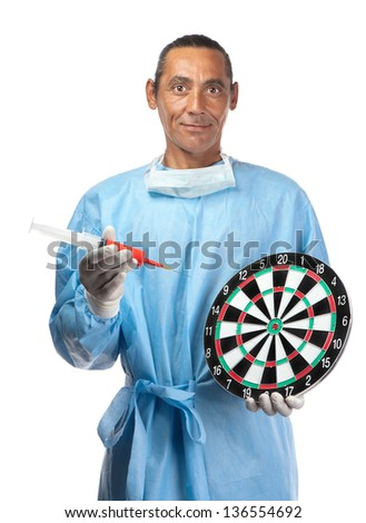 A health care professional points a needle and syringe to a dartboard suggesting target practice or targeting health care. - stock photo