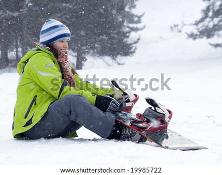 A  health lifestyle image of young adult beautiful snowboarder girl - stock photo