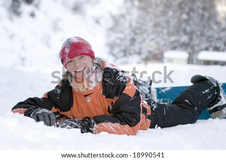 A health lifestyle image of young adult snowboarder after incidence - stock photo