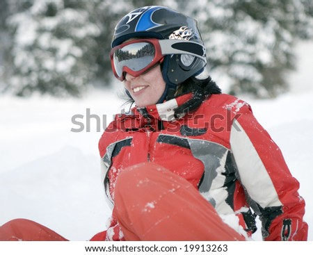 A health lifestyle image of young adult  snowboarder girl after incidence - stock photo