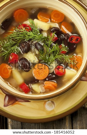 A healthy vegetarian bean soup in bowl on old wooden table  - stock photo