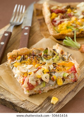 A healthy vegetarian pizza with mushrooms, tomatoes, sweet corn  and zucchini - stock photo
