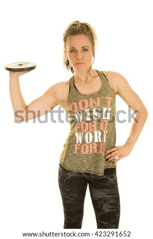 A healthy woman holding on to a weight on the palm of her hand. - stock photo