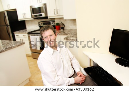 a healthy young man in home office - stock photo