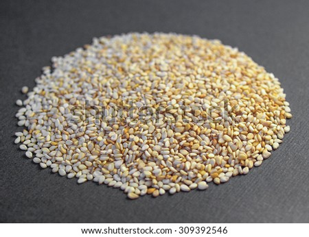 A heap of brown yellow sesame seeds