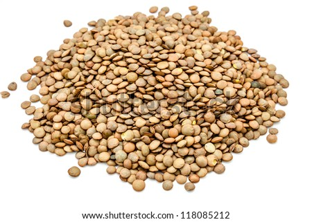 A heap of green lentils on a white background
